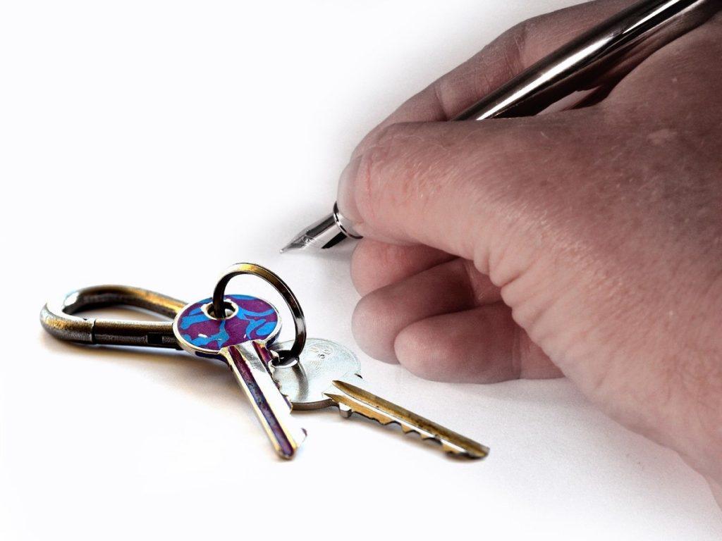 landlord writing and house keys