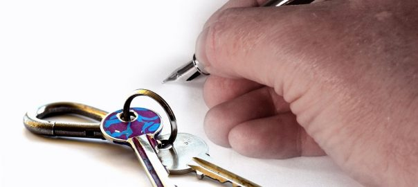 landlord writing and house keys