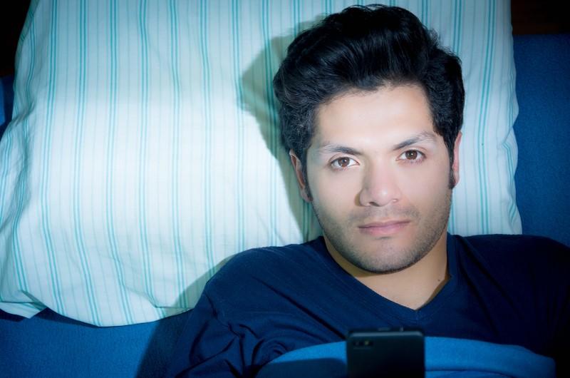 Man suffering with sleep paralysis