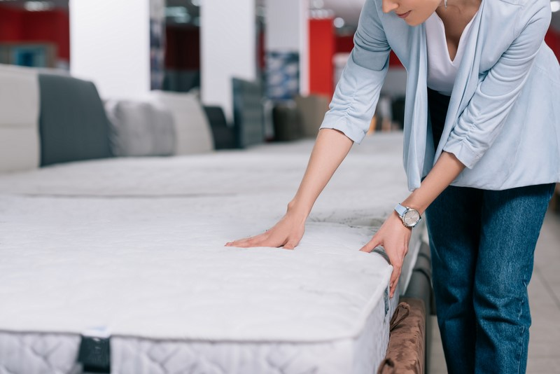 woman touching mattress