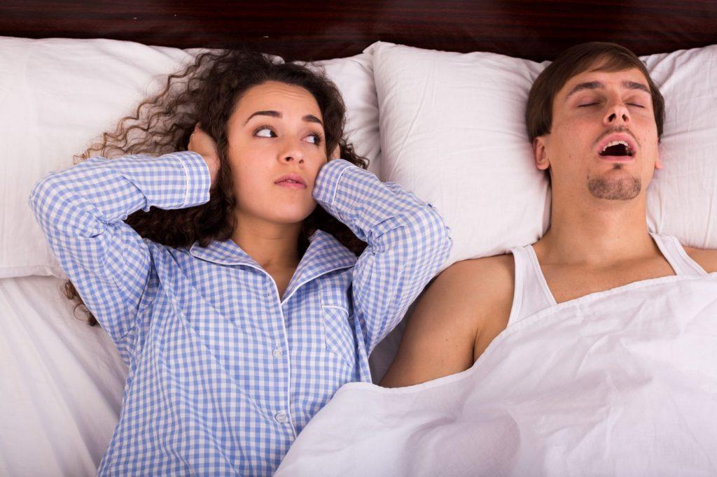 Man Snoring and Keeping woman awake