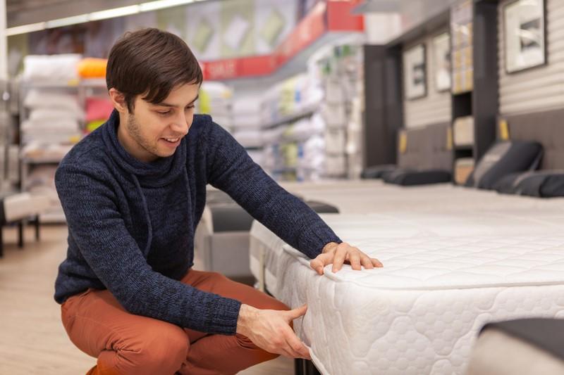 man buying a new mattress