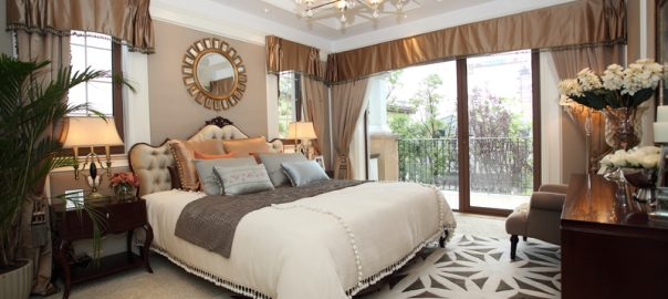 picture of a double bed, mirror and light on the ceiling